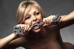 Angry woman biting a chrome chain Royalty Free Stock Photo