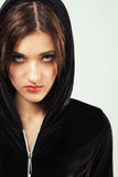 Angry woman in black hood. Portrait of a young angry woman in black hood Royalty Free Stock Images