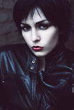 Angry woman in black jacket. In dark Stock Photos