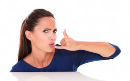 Angry woman in blue shirt gesturing a call Royalty Free Stock Images