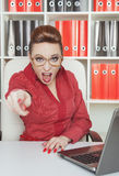Angry woman boss pointing out. Angry woman boss in eyeglasses pointing out at someone stock photos