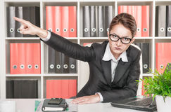 Angry woman boss pointing out. At someone Royalty Free Stock Image