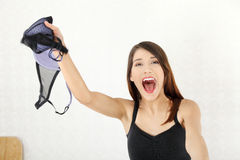Angry woman with bra in hand. Royalty Free Stock Image
