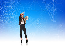 Angry woman builder with helmet and megaphone Stock Photo