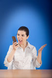 Angry woman calling at phone Royalty Free Stock Photo