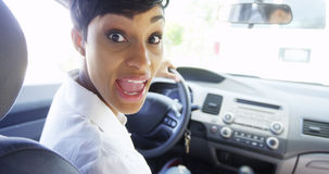 Angry woman in car looking over shoulder and shouting at passenger Stock Photography