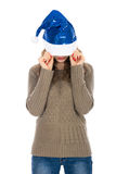 Angry woman with a christmas hat covering her eyes against a whi Stock Images