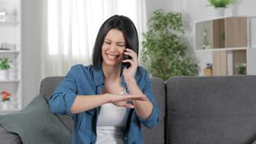Angry woman claiming on phone at home. Angry woman claiming on phone sitting on a couch in the living room at home stock video