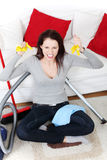 Angry woman cleaning up at home. Stock Images