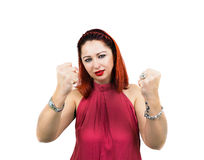 Angry woman with clenched fists. Woman with clenched fists and a furious glance, looking at the camera. White background Royalty Free Stock Photography