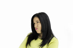 Angry woman. Closeup of a young angry woman with white background Royalty Free Stock Photos