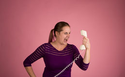 Angry Woman on Corded Phone Royalty Free Stock Photos