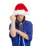 Angry woman in coveralls and Santa hat Royalty Free Stock Photography