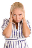 Angry woman covering ears Stock Photo