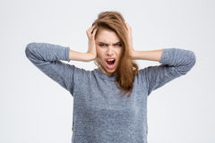 Angry woman covering her ears Royalty Free Stock Photos