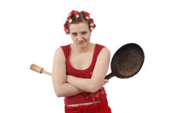 Angry woman with curlers in her hair. Royalty Free Stock Photo