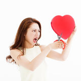 Angry woman cutting the heart shape by  scissors Stock Image