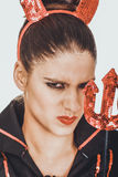 Angry woman in devil carnival costume. Stock Images