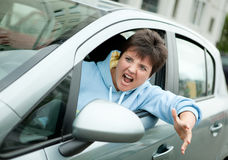 Angry Woman Driver Shouts Stock Photo