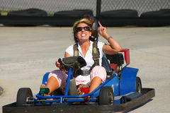 Angry woman driving go cart Royalty Free Stock Photos