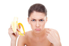 Angry woman eating a banana Stock Image