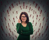 Angry woman exclamation marks. Angry woman wearing eyeglasses nervous gesturing. Annoyed lady scolding someone, anxiety, stress and headache feeling as royalty free stock images