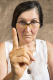 Angry woman with finger pointing up Royalty Free Stock Image