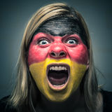 Angry woman with flag of Germany painted on face Royalty Free Stock Image