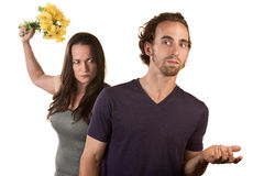 Angry Woman with Flowers and Naive Man. Woman ready to throw flowers at naive white male Stock Photo
