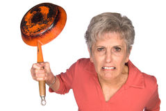 Angry woman with frying pan Royalty Free Stock Photo