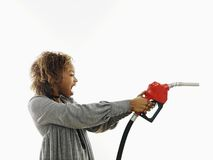 Angry woman with gas nozzle Royalty Free Stock Photos