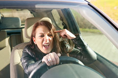 Angry woman gesturing in the car Royalty Free Stock Image