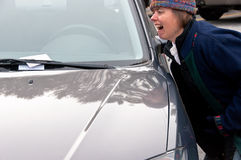 Angry woman gets a parking ticket Royalty Free Stock Photo