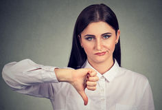Angry woman giving thumbs down gesture stock photos