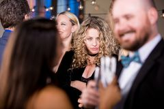 Angry Woman Glaring at Couple. Angry women staring at a happy couple at fancy party royalty free stock photos