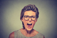 Angry woman with glasses screaming Royalty Free Stock Photography