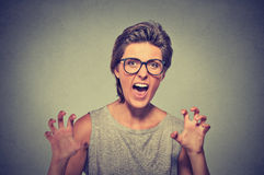 Angry woman with glasses screaming Stock Image