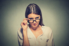 Angry woman with glasses skeptically looking at you Royalty Free Stock Image
