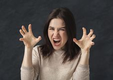 Crazy woman making cat clows gesture. Angry woman growling and making cat claws gesture. Wildness concept royalty free stock photography