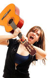 Angry woman with a guitar Stock Photography