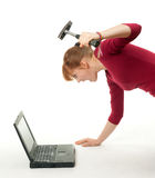 Angry woman from hammer and laptop Stock Photo