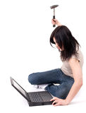 Angry woman with hammer and laptop Stock Images