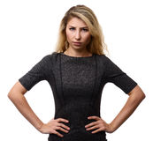 Angry woman with hands on hips Stock Images