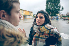 Angry woman having argument to man in quarrel Stock Image
