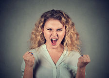 Angry woman having nervous breakdown screaming. Angry young woman having nervous breakdown screaming fists up in air Royalty Free Stock Photos