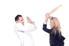 Angry woman hitting her partner in a fight Royalty Free Stock Images
