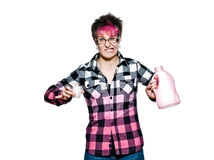 Angry woman holding detergent Royalty Free Stock Photography