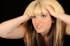 Angry woman holding head Royalty Free Stock Image
