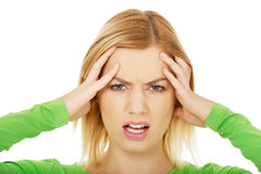 Angry woman holding her head. Royalty Free Stock Photography