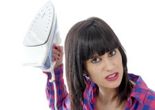 Angry woman holding an iron Royalty Free Stock Images